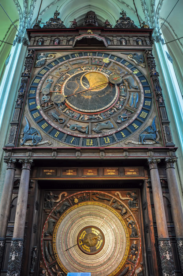 Zodiac Clock in St. Mary's Church of Rostock, Germany. Astronomical tower clock showing zodiac signs and heavenly figures St. Mary's Church, Rostock, Germany royalty free stock photos
