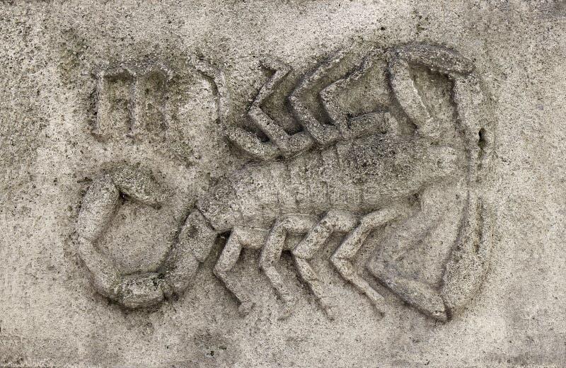 Zodiac - Scorpio or Scorpion. A stone relief royalty free stock photo