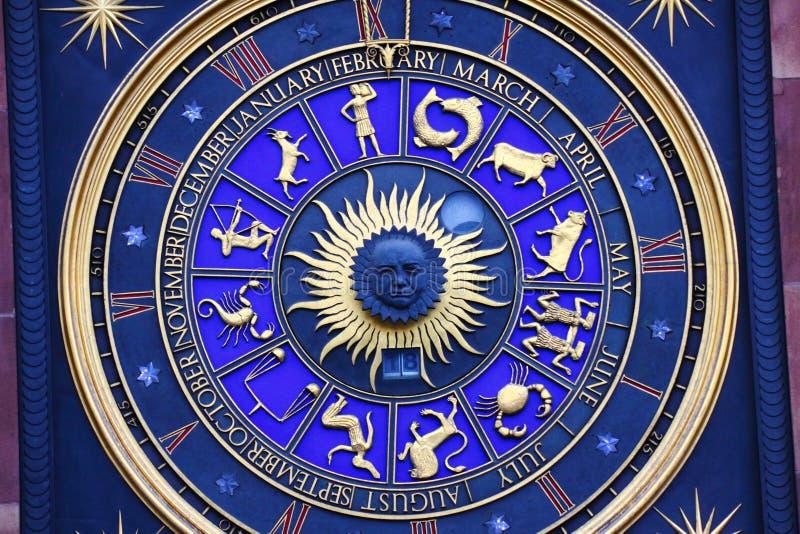 Zodiac signs on clock royalty free stock photo