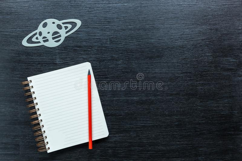 Constellations. Zodiacal star, constellations on a black background with a notepad and pencil royalty free stock image