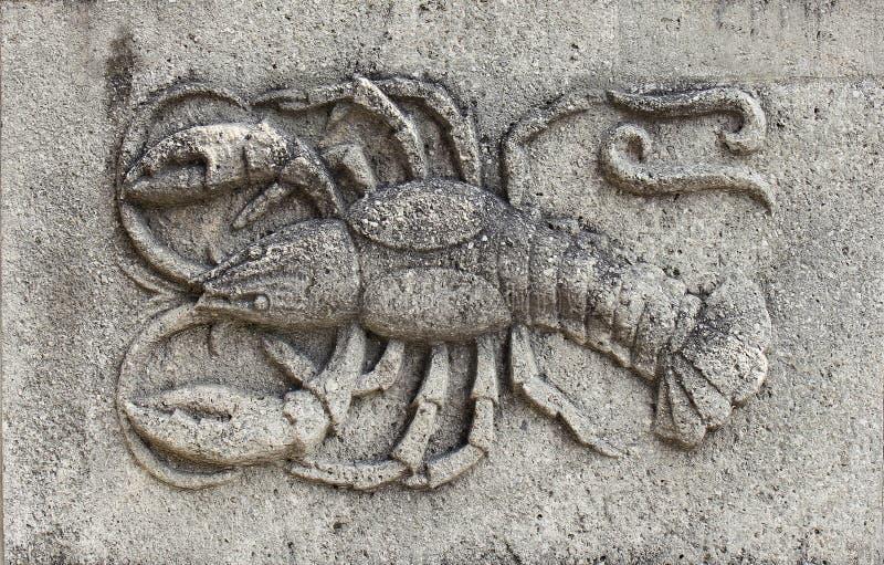 Zodiaco - scorpione, un sollievo di pietra immagine stock