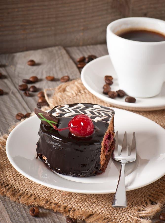 Zoet dessert en een kop van koffie stock afbeelding