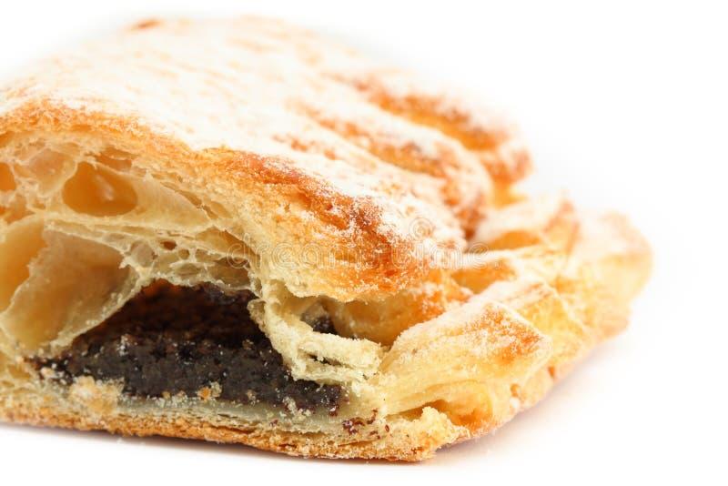 Zoet die broodje met papaverzaad wordt gevuld stock foto
