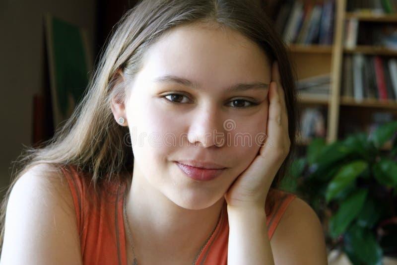 Zoet meisje door het venster royalty-vrije stock foto