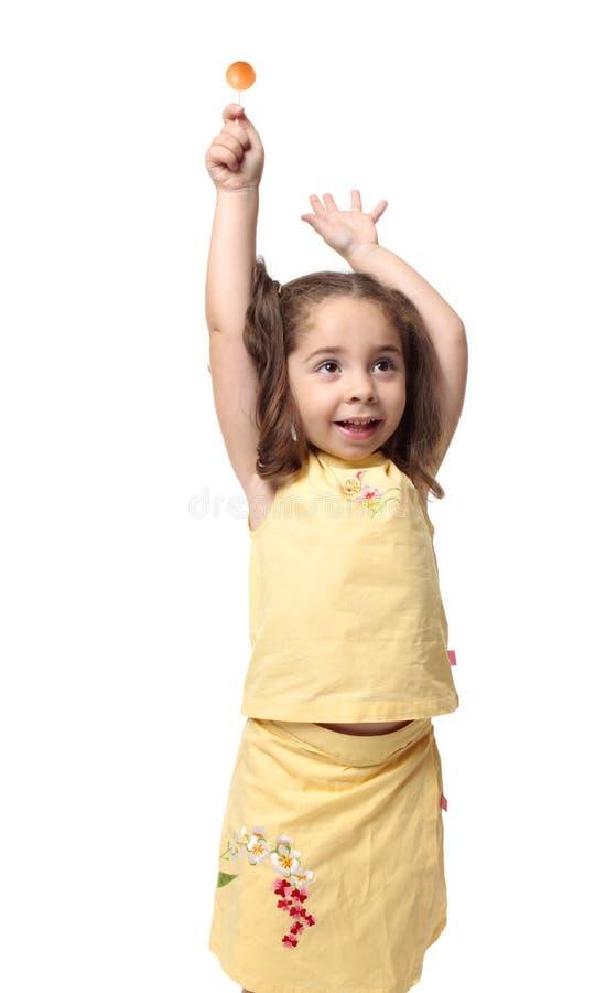 Zoet meisje met suikergoedlolly stock afbeelding