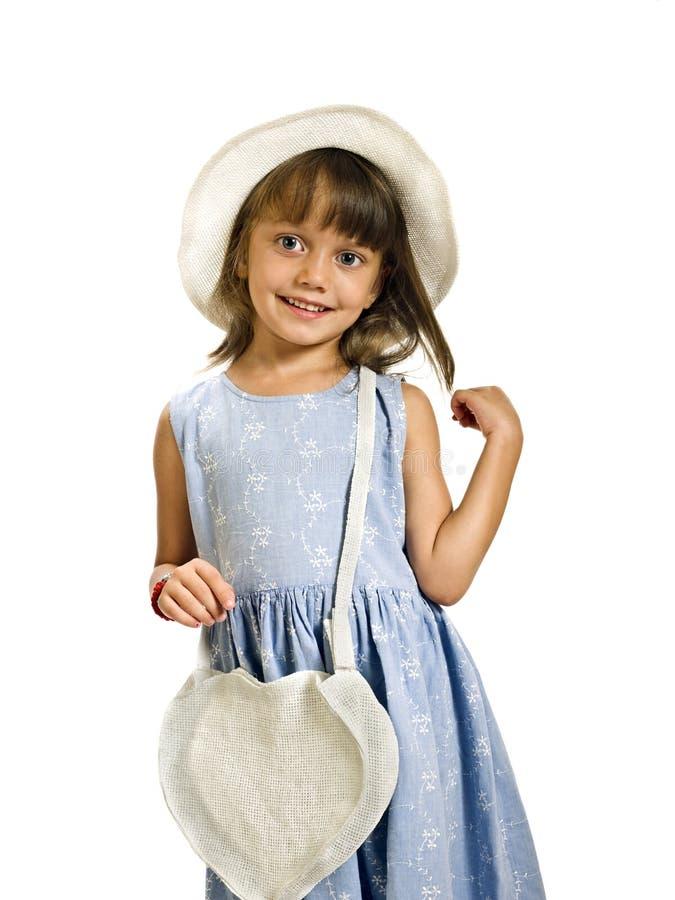 Zoet meisje met witte hoed en zak stock foto's