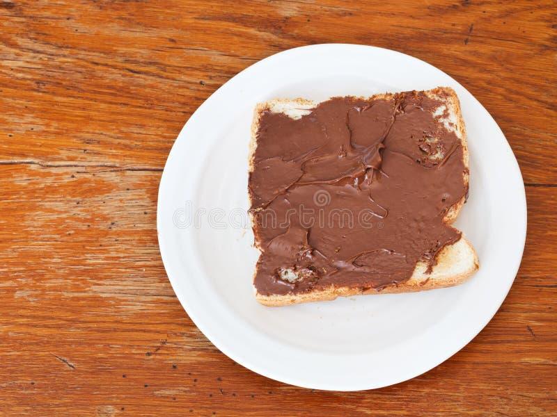 Zoete sandwich - toost met uitgespreide chocolade stock fotografie