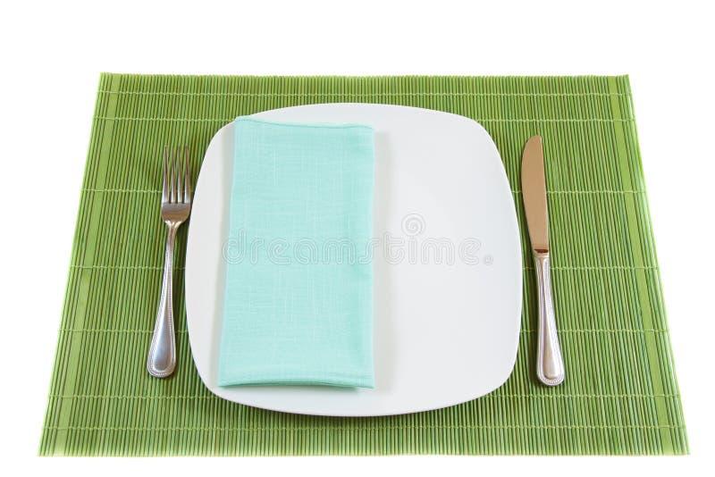 Zolla di pranzo vuota bianca con il tovagliolo immagine stock