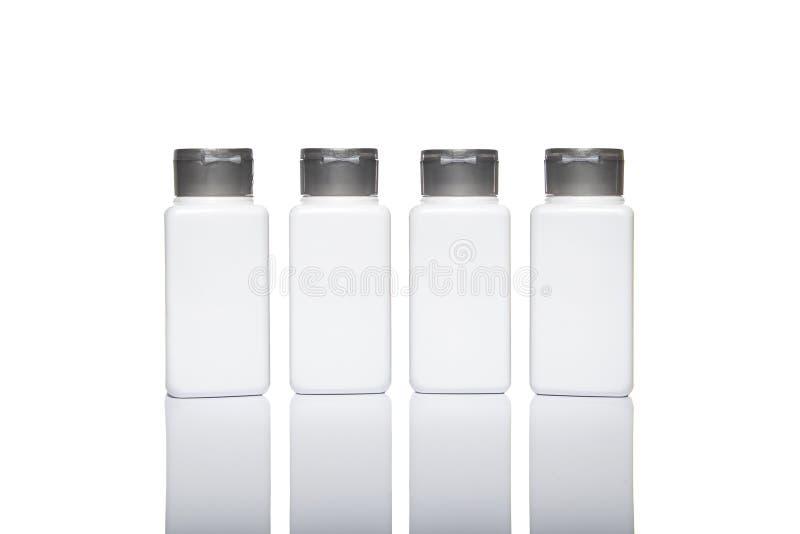 Zombaria da placa acima da propaganda com espaço da cópia das garrafas brancas w imagens de stock
