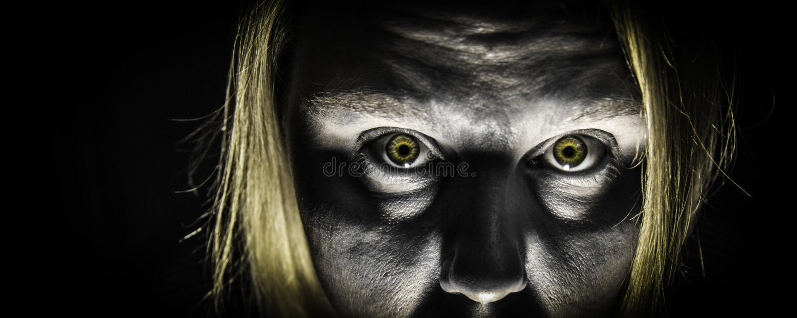 Zombie Attack. A panoramic photo of a zombie with bright yellow zombie eyes stock photos
