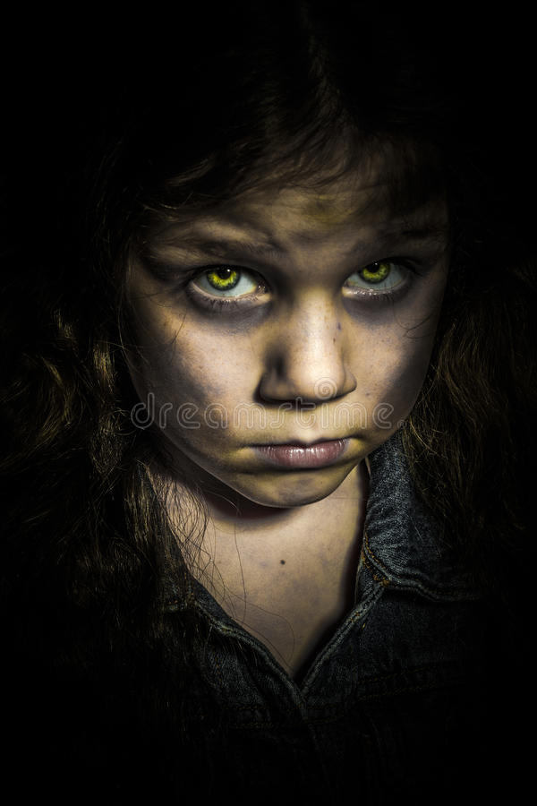 Zombie Child. A photo of a little girl zombie with yellow zombie eyes stock photo