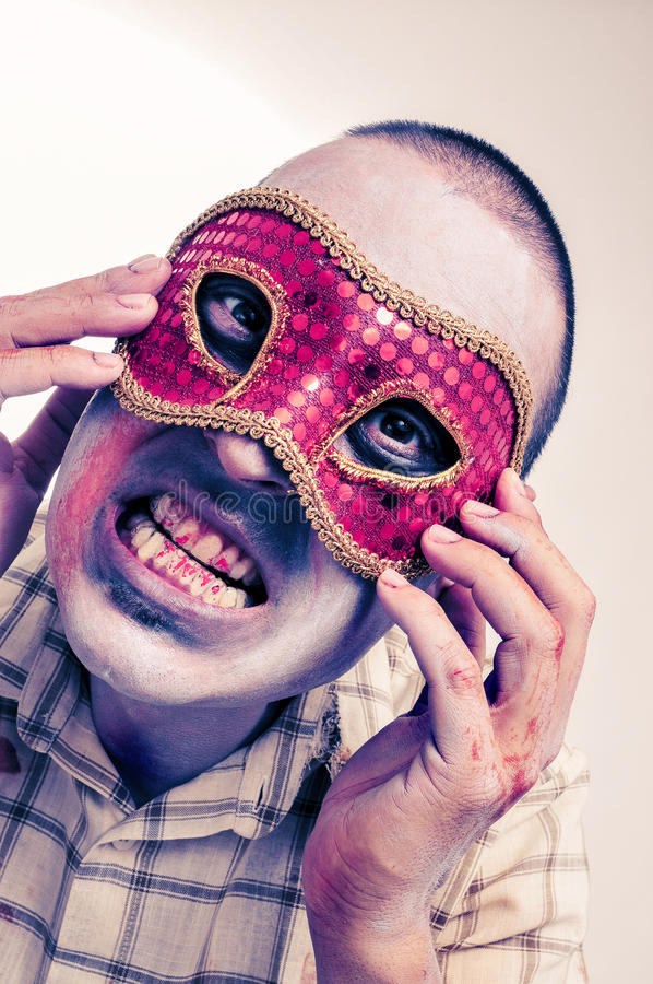 A zombie with a fancy mask stock photos