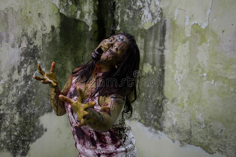 Zombie girl. In haunted house scary stock photography