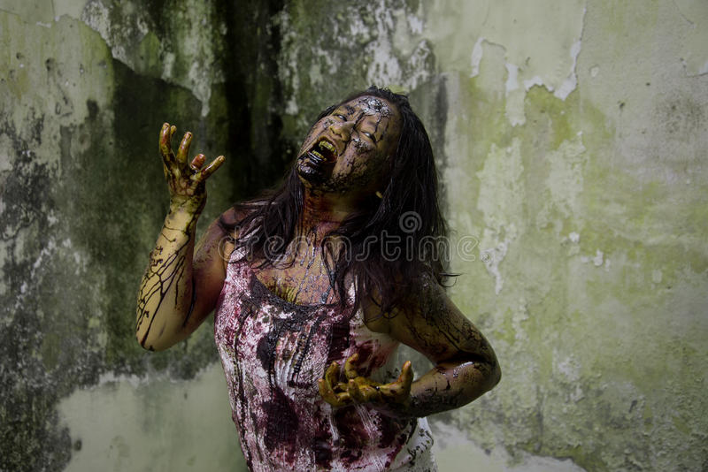 Zombie girl. In haunted house scary stock photos