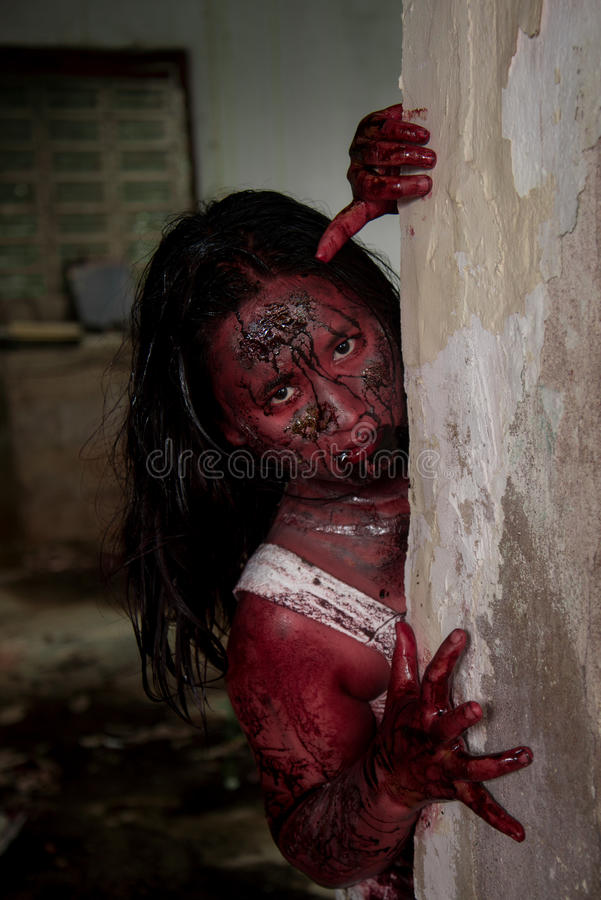 Zombie girl. In haunted house scary royalty free stock photo