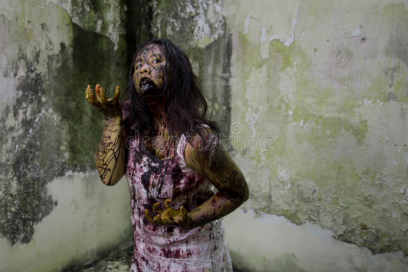Zombie girl. In haunted house scary stock photo