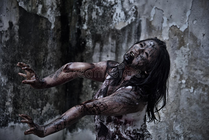 Zombie girl in haunted house royalty free stock image