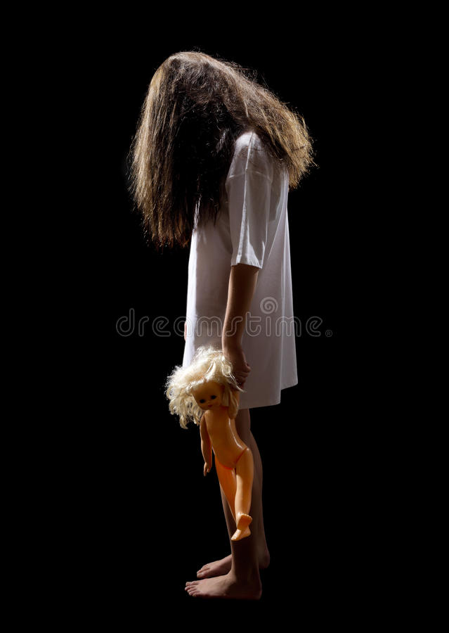 Zombie girl with plastic doll royalty free stock photo
