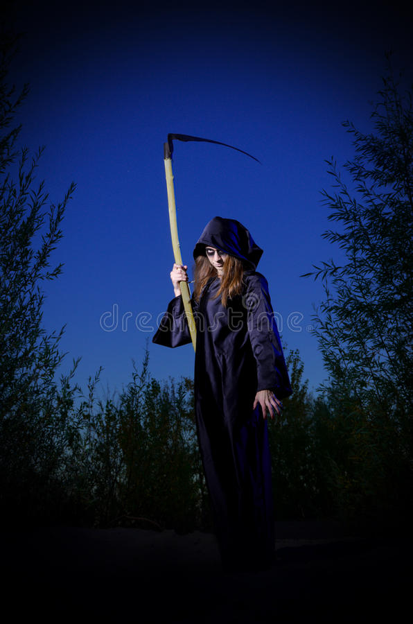 Zombie girl with scythe stock photography