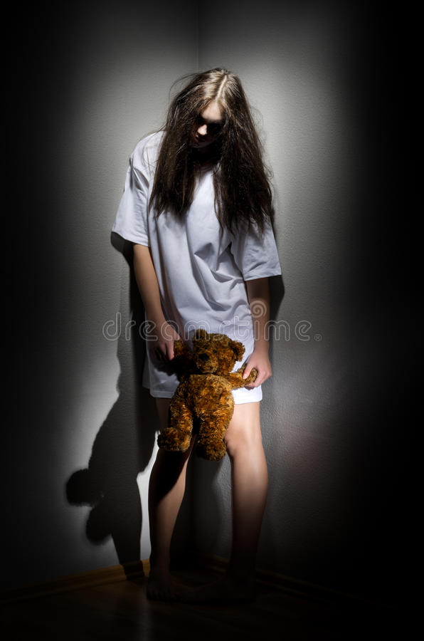 Zombie girl with teddy bear stock image