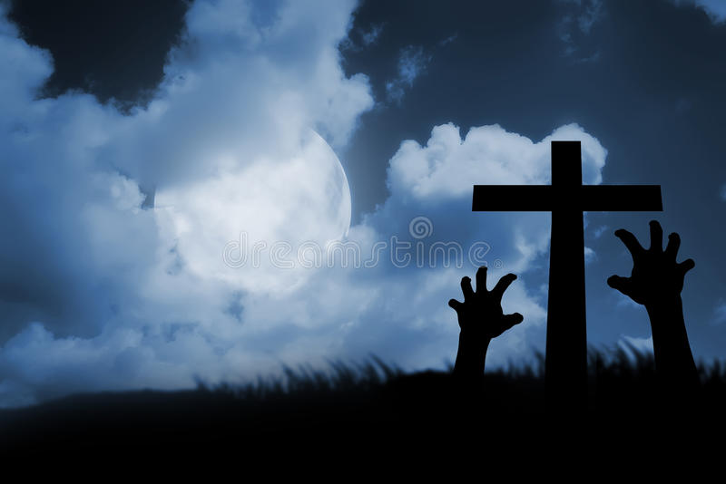 Zombie hand coming out of his grave stock photos