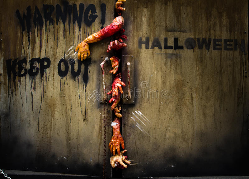 Zombie hand through the door royalty free stock image