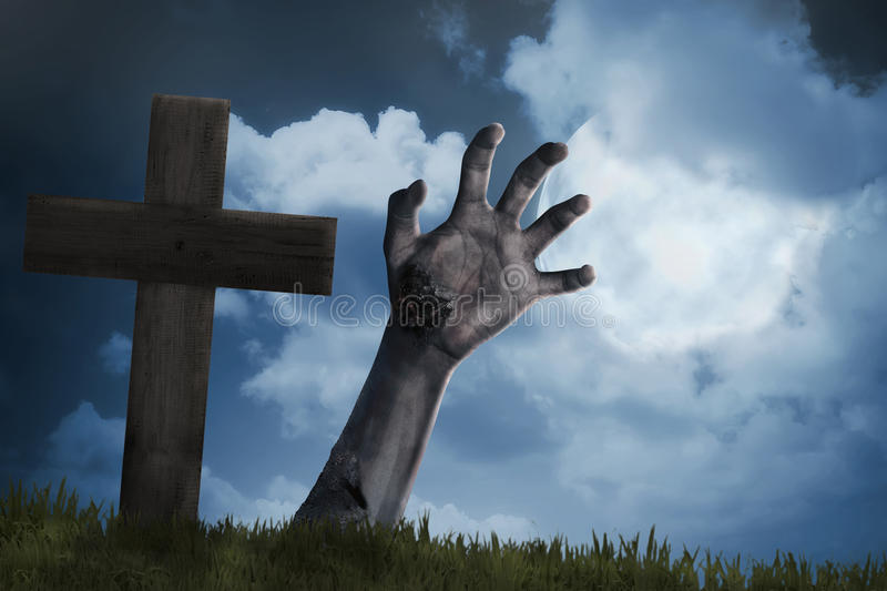 Zombie hand out from the graveyard stock photos