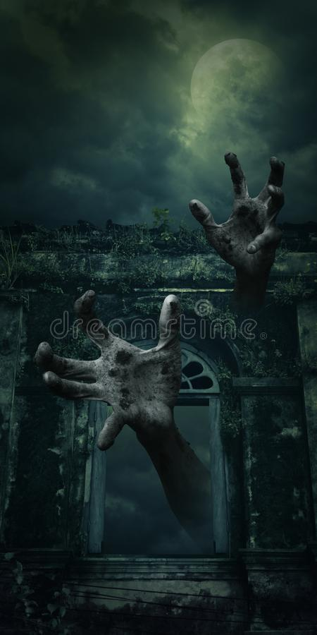 Zombie hand rising out from spooky ancient castle window over full moon with cloudy sky stock images
