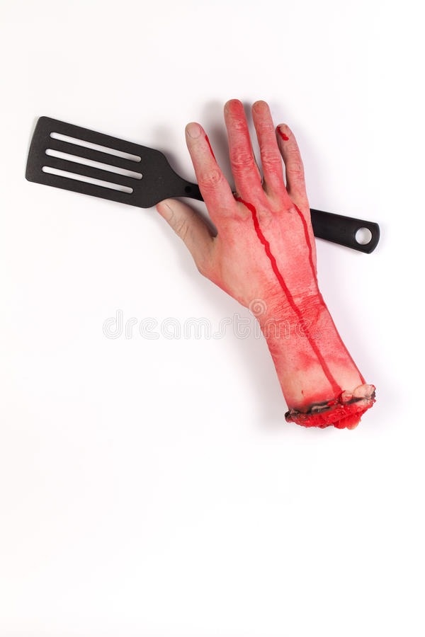 Zombie Hand with spatula ,flipper ,spade of frying pan stock photography