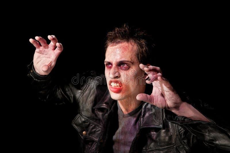 Zombie im Scheinwerfer stockfotos