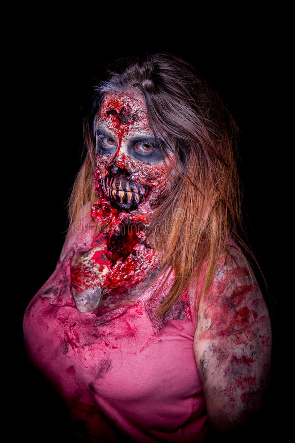 Zombie makeup. Portrait of zombie girl with bloody makeup and latex prosthesis stock image