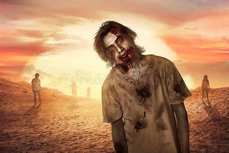 Zombie man walking in the dessert. Zombie man walking in the desert at sunset stock photography