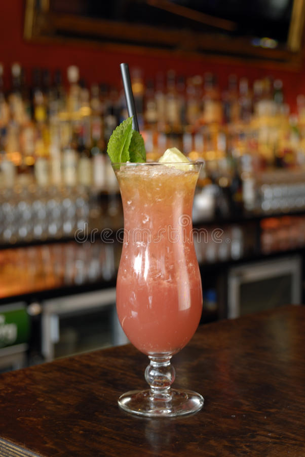 Zombie Punch. With mint leave black straw in a bar setting stock images