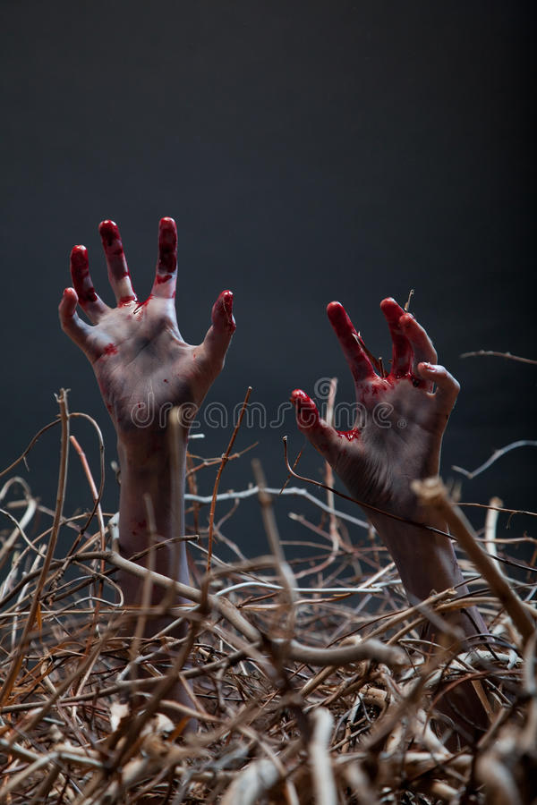 Free Zombie Stretching His Creepy Hands From The Grave Stock Photos - 26806783