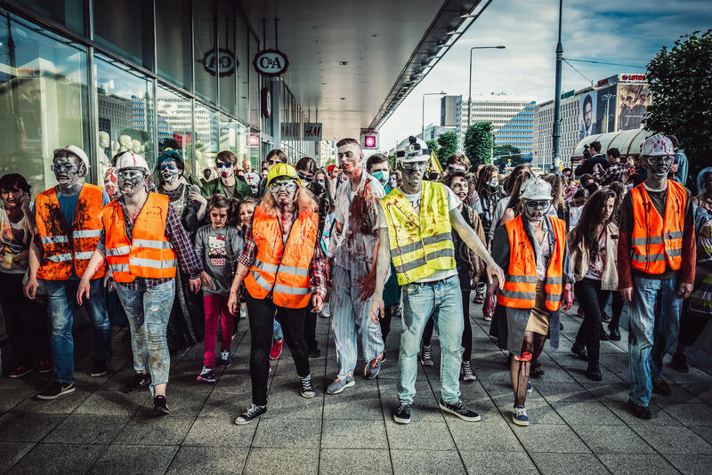 Zombie Walk in Warsaw. WARSAW, POLAND - JUNE 27, 2015: Participants of the 9th Zombie Walk walks on street in Warsaw city center stock image