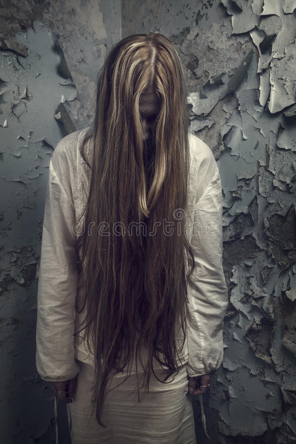 Free Zombie With Loong Hair In An Abandoned Building Royalty Free Stock Photography - 26898647