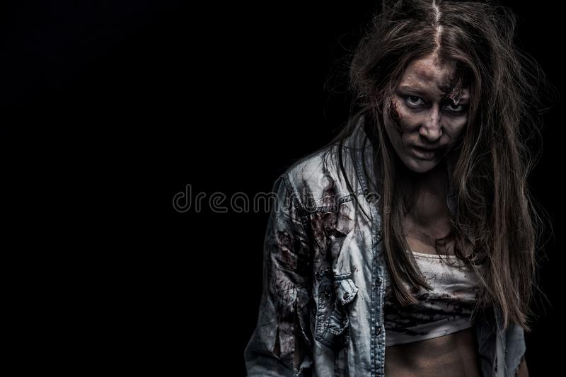Zombie woman, Horror background for halloween concept and book cover. Copy space. Close-up portrait of a horrible scary zombie woman. Horror. Halloween poster stock photo