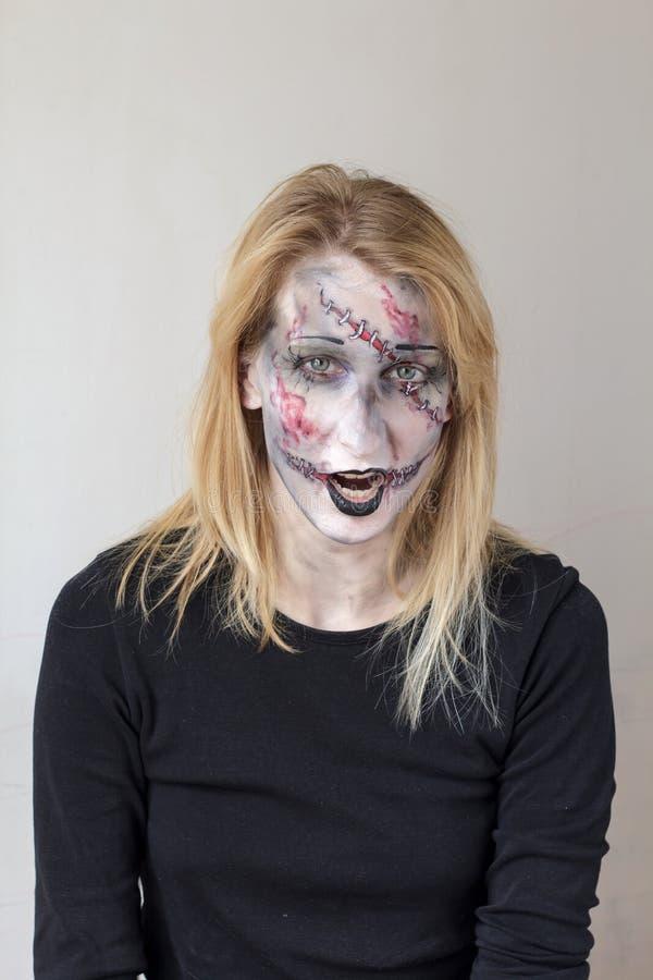 Zombiegezicht het schilderen royalty-vrije stock afbeelding