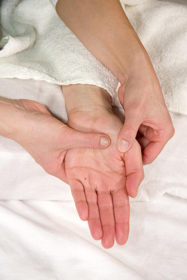 zon för handmassagereflex royaltyfri foto