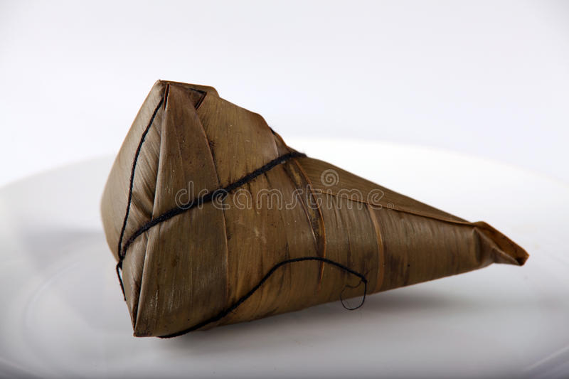 Zongzi on a white plate royalty free stock photo