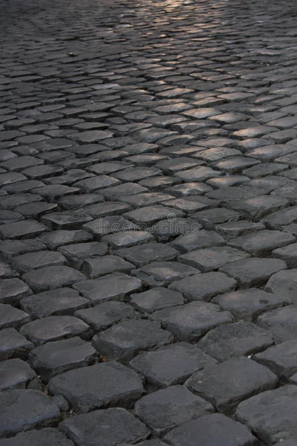 Zonlicht die op Keiweg glanzen in Rome, Italië royalty-vrije stock fotografie