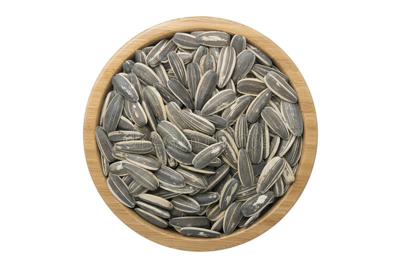 Zonnebloemzaden in houten kom geïsoleerde hoogste mening over witte backgr royalty-vrije stock foto's