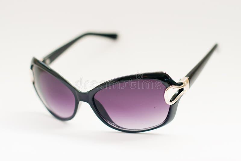 Zonnebril die op witte achtergrond wordt geïsoleerdr royalty-vrije stock afbeelding