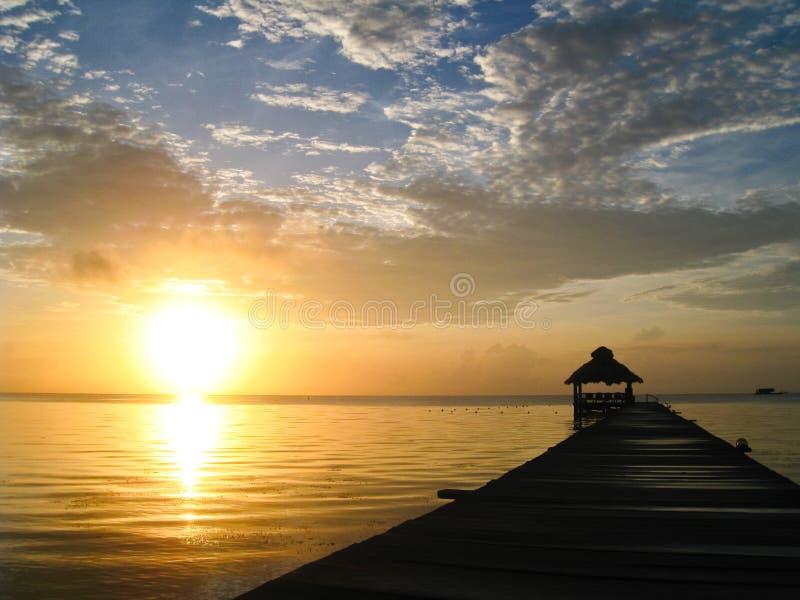 Zonnestraal over Belize stock fotografie