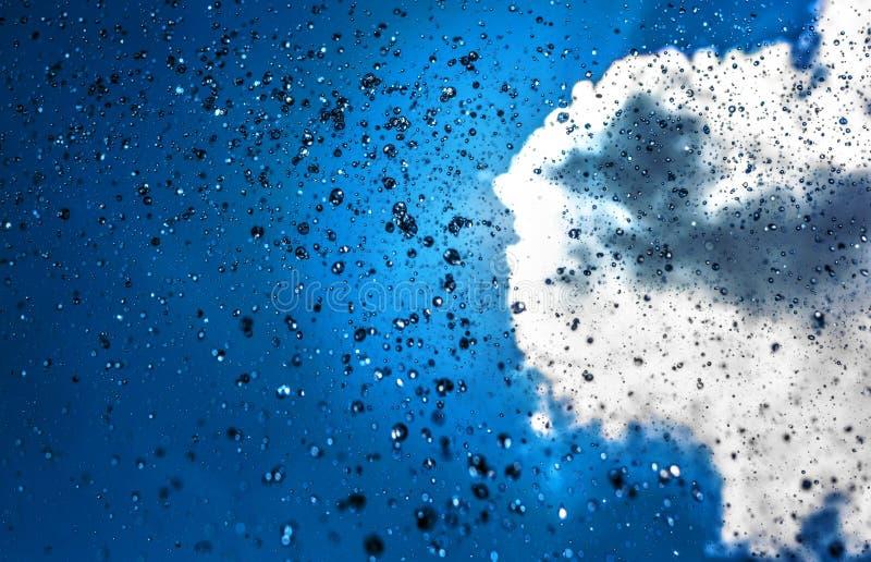 Zonnige regen stock afbeeldingen