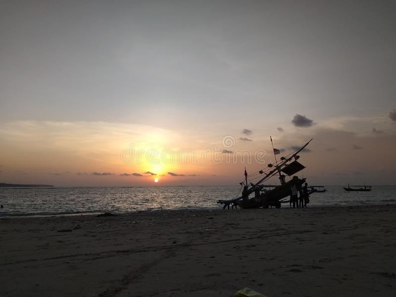 Zonsondergang Bali Kelan Beach stock foto's