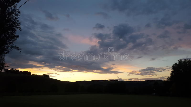 Zonsondergang bij Bergpracht stock foto