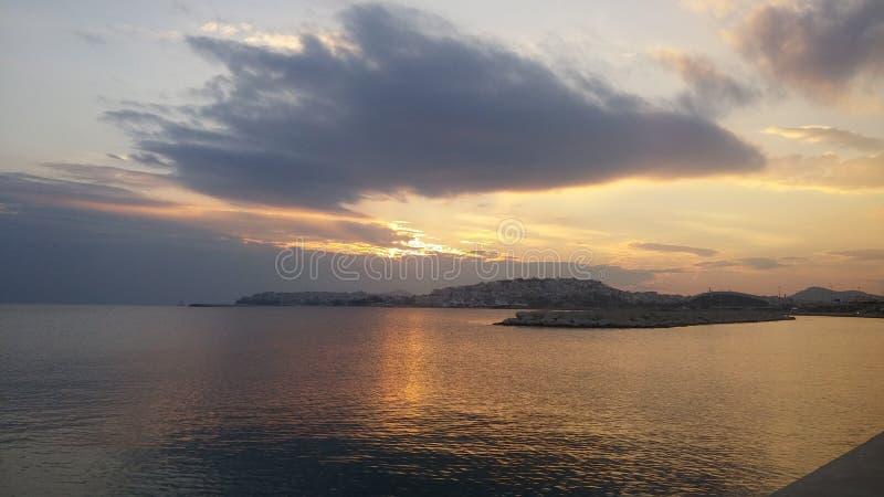 Zonsondergang bij Egeïsche overzees royalty-vrije stock foto's
