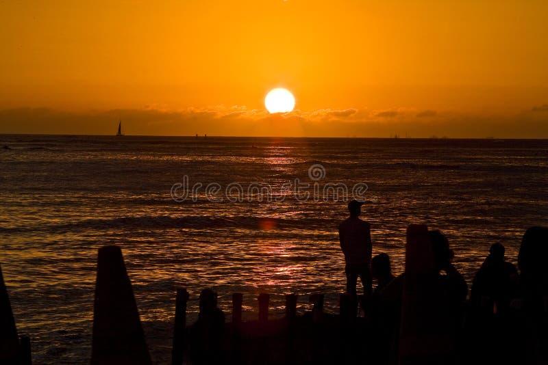 Zonsondergang bij Strand Waikiki stock foto