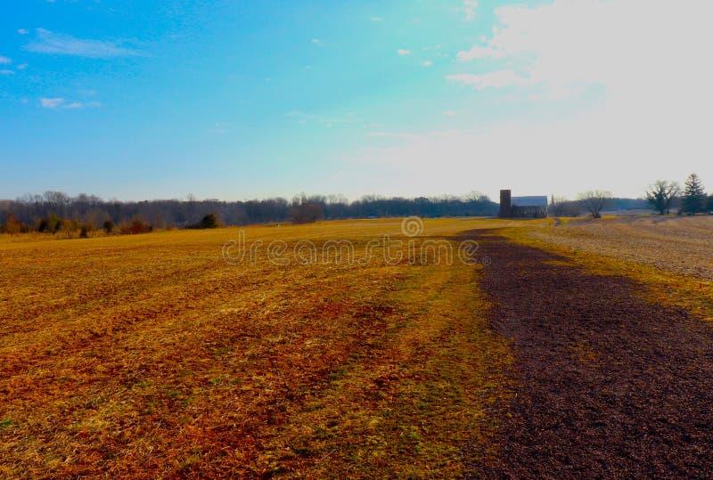 Zonsondergang bijna en Diep Rich Colors van Landbouwgrond stock fotografie